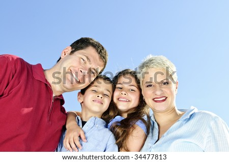 Portrait of happy family of four smiling