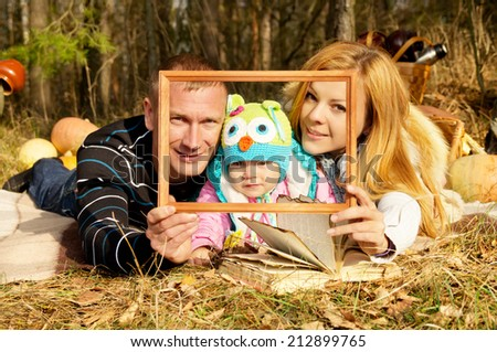 Portrait of happy family on nature autumn - stock photo