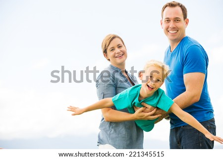 Portrait of Happy Family Outside Playing - stock photo