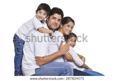 Portrait of happy family over white background - stock photo