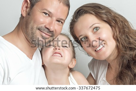 portrait of happy family. Parents and their beautiful cute daughter.  - stock photo