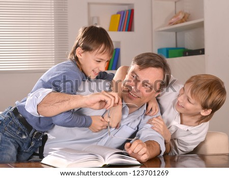 portrait of happy family relaxing at home - stock photo