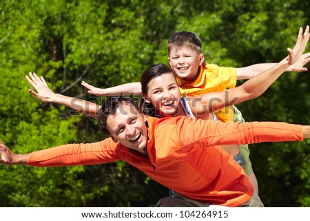 Portrait of happy family stretching arms - stock photo