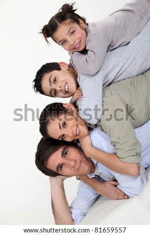 Portrait of happy family, studio shot - stock photo