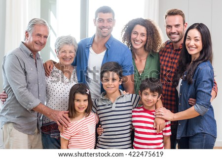 Portrait of happy family together at home - stock photo