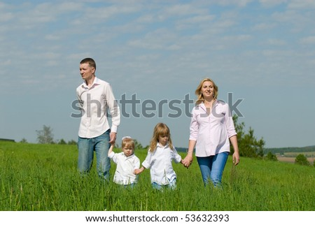 Portrait of happy family with children on rest