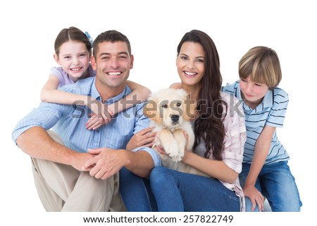 Portrait of happy family with cute dog over white background - stock photo