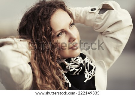 Portrait of happy fashion woman with long curly hairs outdoor  - stock photo