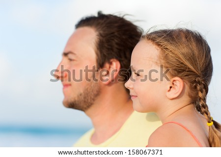 Portrait of happy father and daughter outdoors on summer day