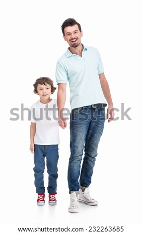 Portrait of happy father and his liitle son, on the white background, are looking at the camera. - stock photo