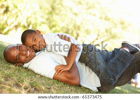 Portrait of Happy Father and Son In Park - stock photo