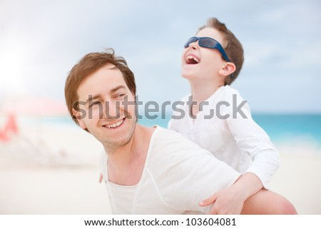 Portrait of happy father and son laughing - stock photo