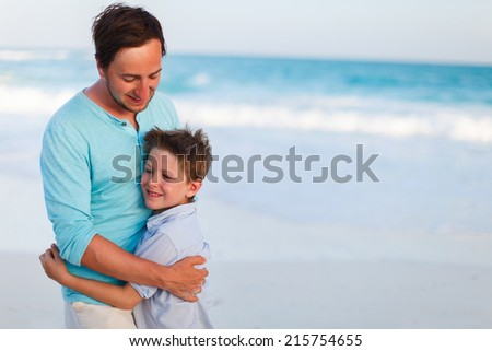 Portrait of happy father and son outdoors