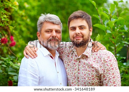 portrait of happy father and son, that are similar in appearance - stock photo