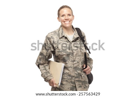 Portrait of happy female airman with shoulder bag and books against white background - stock photo