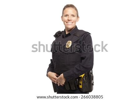 Portrait of happy female police officer standing against white background - stock photo