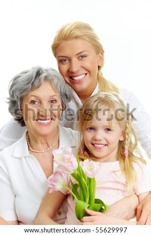 Portrait of happy female relatives looking at camera - stock photo