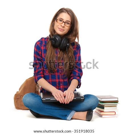 Portrait of happy female student sitting isolated on white. - stock photo