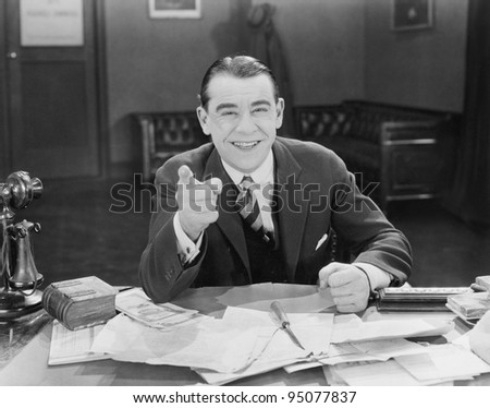 Portrait of happy friendly businessman - stock photo