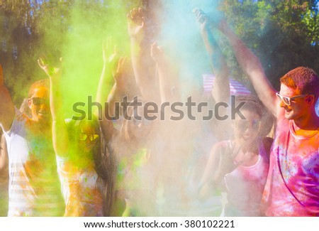Portrait of happy friends on holi color festival - stock photo