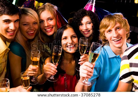 Portrait of happy friends with champagne at birthday party - stock photo