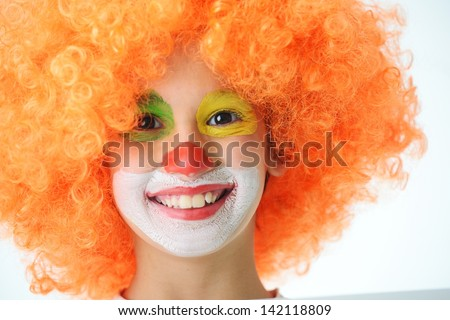 Portrait of happy funny clown kid - stock photo