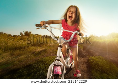 Portrait of happy funny girl on bicycle. Active Leisure Concept. Healthy lifestyle. - stock photo