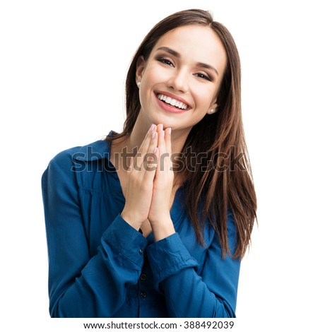 Portrait of happy gesturing smiling young woman in casual smart blue clothing, isolated against white background - stock photo