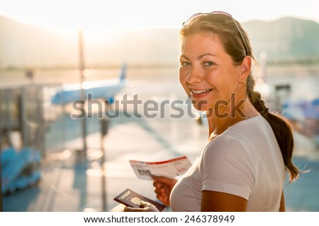 portrait of happy girl at the airport - stock photo