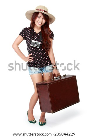 portrait of Happy girl going on vacation bring a suitcase