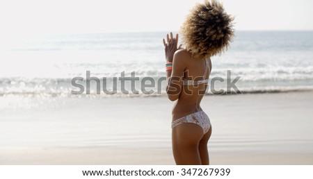 Portrait of happy girl in bikini posing against sea in . - stock photo