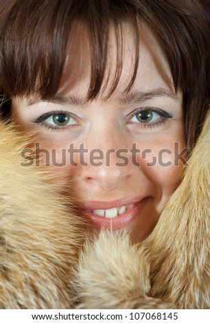 Portrait of happy girl in fox fur