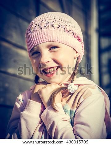 Portrait of happy girl in hat. - stock photo