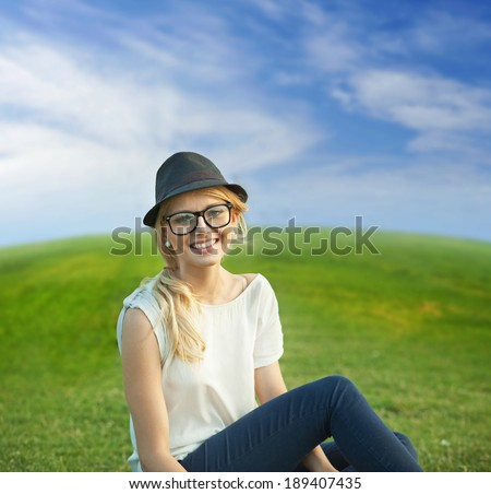 Portrait of happy girl laying on meadow - stock photo