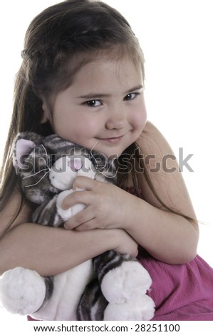 Portrait of happy girl of five hugging teddy bear