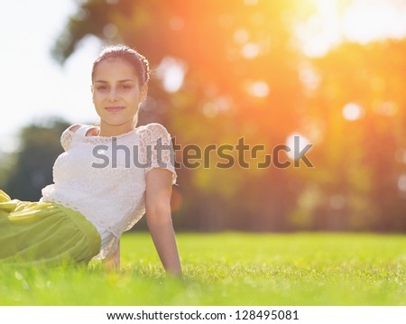 Portrait of happy girl on meadow laying on meadow - stock photo