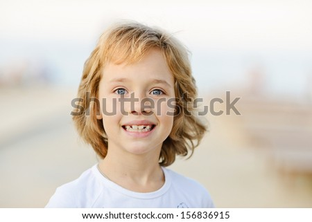 portrait of happy girl outdoors - stock photo