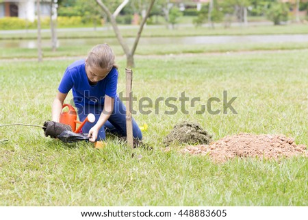 Portrait of Happy Girl Planting Outdoors - stock photo