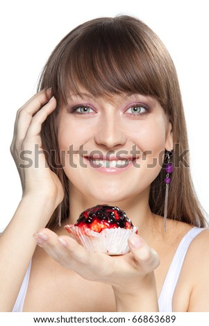 Portrait of happy girl with cake smiling and look at camera isolated on white