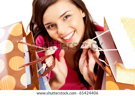 Portrait of happy girl with colorful paper bags looking at camera with smile - stock photo