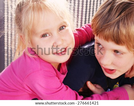 Portrait of happy girl with her autistic brother outdoors  - stock photo