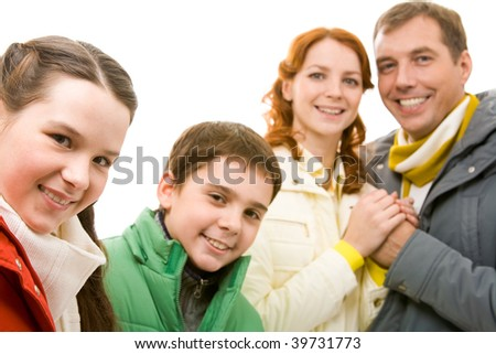 Portrait of happy girl with her brother and parents on background