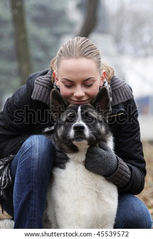 portrait of happy girl with her dog - stock photo