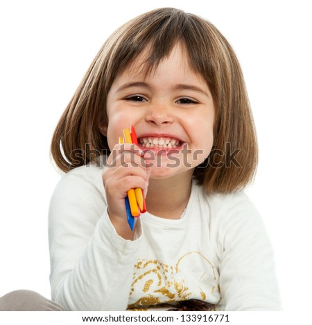 Portrait of happy girl with wax crayons.Isolated. - stock photo