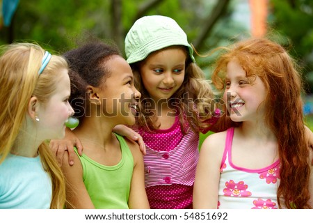Portrait of happy girls chatting outside - stock photo