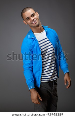 Portrait of happy, good-looking guy in trendy blue jacket - stock photo