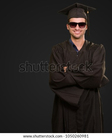 Portrait Of Happy Graduate Man Isolated On Black Background