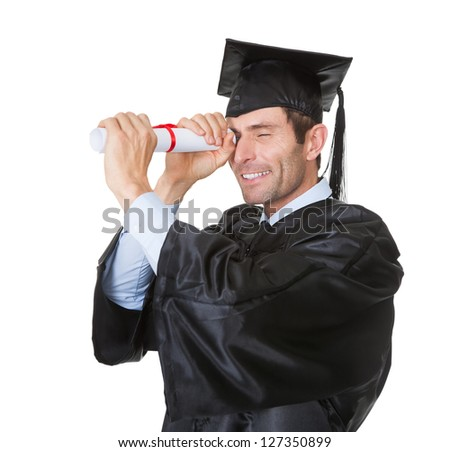 Portrait of happy graduate student looking into the future. Isolated on white
