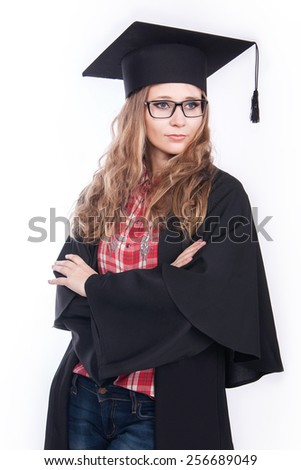 Portrait of happy graduate young woman in casual cloth and glasses - stock photo