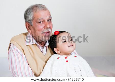 portrait of happy grandfather and grand daughter, grandfather and grandchild - stock photo